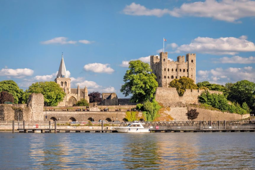 Rochester, England, UK - June 7, 2015: View of historical Rochester across river Medway in sunny afternoon.